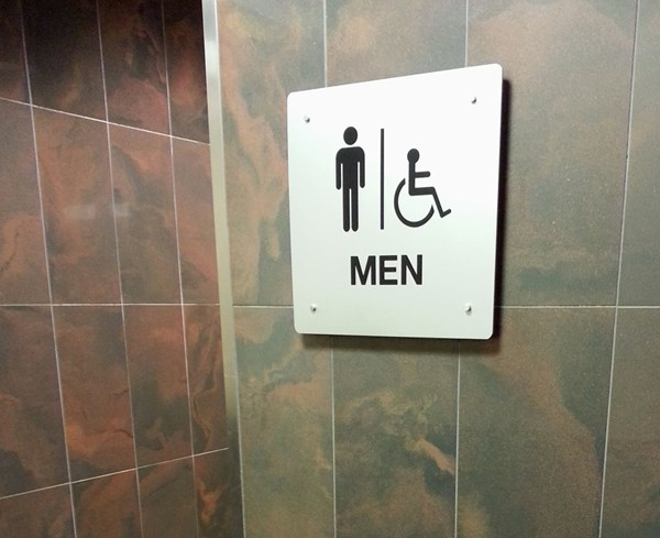 ADA restroom sign in silver and black for Gurnee Mills Mall,  Gurnee, IL