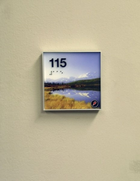 Digital print inserted into a wall frame with ADA numbers