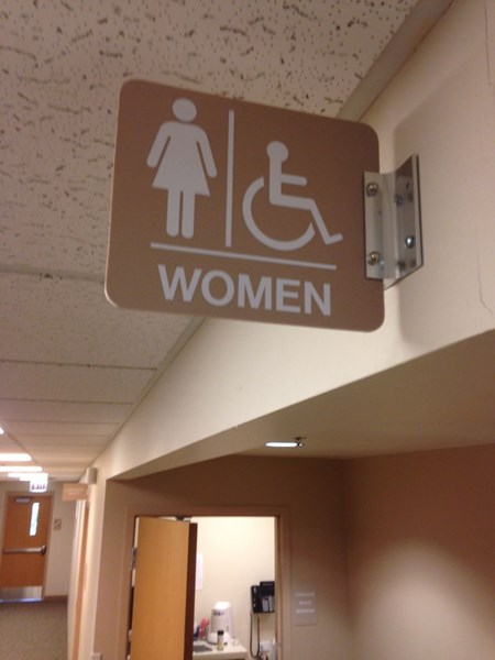 Wall mounted restroom sign