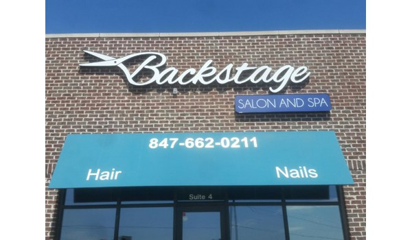 LED lighted channel letters with cloud box for Backstage Salon and Spa.  Gurnee, IL