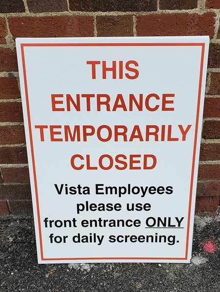 Sign to direct hospital employees to use one entrance only